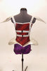 Red & purple short unitard has silver cage-like crystaled strap accents on torso that double as straps. Shoulders & hips have silver padded, embellishments. Back