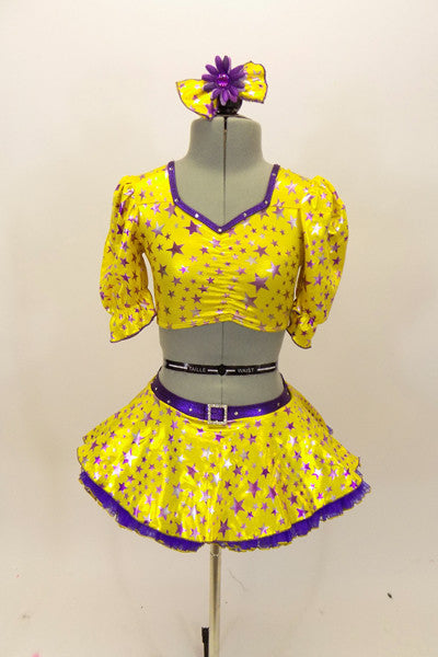 Bright yellow base with purple star print half top has large pouf sleeves with crystaled purple piping. Matching skirt has purple petticoat & bow hair accessory. Front