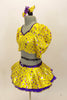 Bright yellow base with purple star print half top has large pouf sleeves with crystaled purple piping. Matching skirt has purple petticoat & bow hair accessory Left side