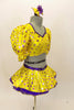 Bright yellow base with purple star print half top has large pouf sleeves with crystaled purple piping. Matching skirt has purple petticoat & bow hair accessory. Right side