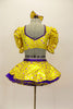 Bright yellow base with purple star print half top has large pouf sleeves with crystaled purple piping. Matching skirt has purple petticoat & bow hair accessory. Back