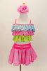 Pastel costume has tri-colored top in layered ruffles of glittery blue pink and green. The skirt is glittery pink with bright pink waistband and decorative pink crystal buckled belt. Comes with pastel pink floral hair accessory. Front