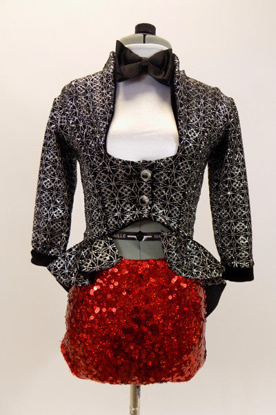 White  high collar crop sits below high waisted,black & silver peplum tailcoat. The bottom is red sequined brief . Has black bow-tie & sequined black top hat. Front