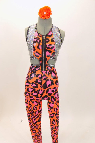Unitard is two piece orange & pink leopard print joined by large black zipper at front. Halter top has with sequined sides. Has striped belt & hair accessory. Front