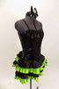 Black sequined & boned corset dress has grommet & lace  back. Has attached skirt with layers of ruffled green & black satin. Has separate panty & hair accessory. Right side