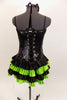 Black sequined & boned corset dress has grommet & lace  back. Has attached skirt with layers of ruffled green & black satin. Has separate panty & hair accessory. Back