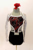 Black velvet halter style top has large swirls of red and silver. The top is connected to the short at mid-torso and has crystal belt buckle accent. The black shorts have a matching swirled peplum bustle. Comes with silver sequined shrug and red-silver floral hair accessory. Front