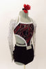 Black velvet halter style top has large swirls of red and silver. The top is connected to the short at mid-torso and has crystal belt buckle accent. The black shorts have a matching swirled peplum bustle. Comes with silver sequined shrug and red-silver floral hair accessory. Right side