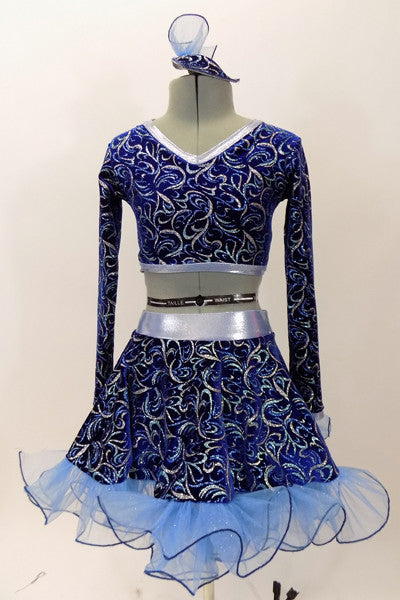 Long sleeved half top & skirt with curly ruffle and petticoat, are a navy blue velvet base with aqua & silver swirl patterns. Costume has matching head piece. Front