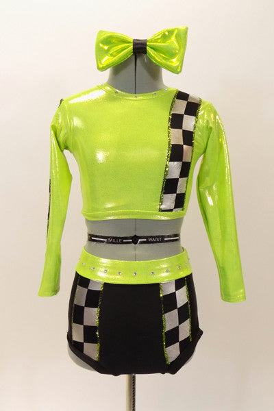 Lime green half top has black-silver racing check pattern on sleeve, bodice & on matching briefs. Comes with matching checkered legwarmer/socks & lime green hair bow. Front