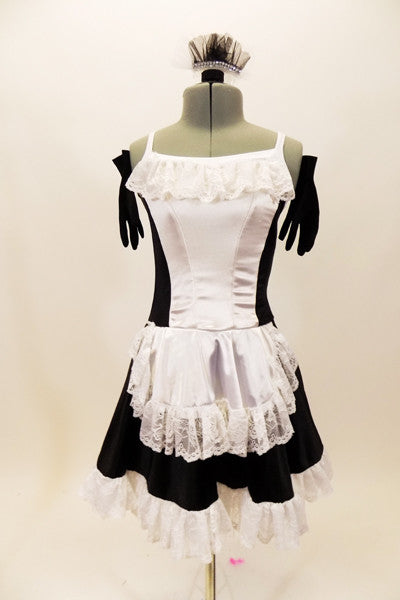 Black sateen French maid dress has princess seams with white center on bodice and attached white apron. The edge of the skirt, apron and bust has wide French lace trim. Comes with ruffled hair accessory & black gloves. Front