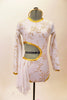 Long sleeved white  leotard  has golden floral pattern, cut-out back & right side with 3 back straps. Has white chiffon kerchiefs at right hip & hair accessory. Front
