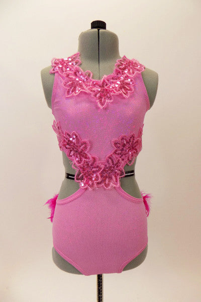 Pink glitter leotard has open sides and back with sequined floral appliques along bust and sides Back has hot pink boa feathers. Comes with hair accessory. Front