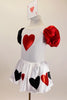 White velvet leotard dress has heart motif on bodice.White satin skirt has alternating red & black hearts over white petticoat. Has ace of hearts hair piece. Left side