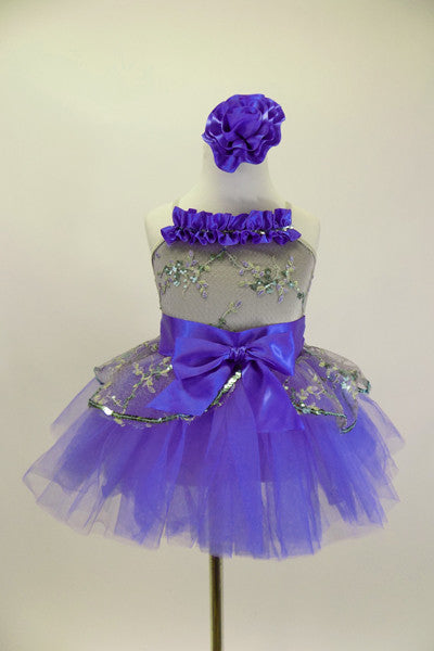 Silver camisole leotard dress has silver lace overlay. Lace peplum sit on the periwinkle blue tutu skirt. Has satin waist with bow & ruffle along bust & hair accessory. Front