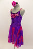 Purple crushed velvet leotard dress has long chiffon attached skirt with purple & fuchsia waves. Bodice has large sequined floral applique. Has rose hair piece. Left side