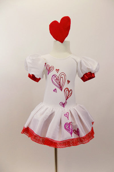 White velvet leotard dress has pouf sleeves with red cuffs. hand painted glittery hearts cascade down the bodice and skirt . There is a red tulle petticoat and the skirt is edged with red lace Comes with heart hair accessory. Front