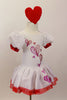 White velvet leotard dress has pouf sleeves with red cuffs. hand painted glittery hearts cascade down the bodice and skirt . There is a red tulle petticoat and the skirt is edged with red lace Comes with heart hair accessory. Side
