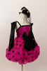 Hot pink sequined bodice has pink-black polk-a-dot bubble skirt with black satin front bow. Comes with black satin gauntlets and glittery black veiled top-hat. Right side