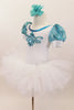 White velvet leotard has turquoise lace sleeves. Neckline has turquoise sequins & large jeweled applique. Comes with white tutu skirt & floral hair accessory. Left side