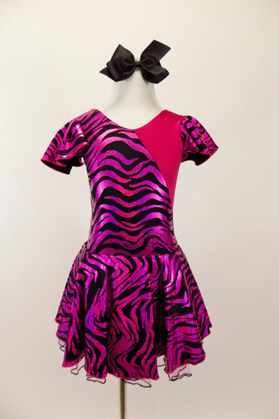 Hot pink metallic and zebra pattern, cross front leotard dress has zebra print ruffled cap sleeves and skirt with solid pink back.  Comes with black bow hair accessory. Front