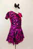 Hot pink metallic and zebra pattern, cross front leotard dress has zebra print ruffled cap sleeves and skirt with solid pink back.  Comes with black bow hair accessory. Right side