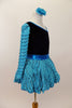 Black velvet leotard has single sleeve of soft, layered turquoise ruffles. Comes with matching turquoise ruffled skirt with petticoat and floral hair accessory. Right side