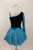 Black velvet leotard has single sleeve of soft, layered turquoise ruffles. Comes with matching turquoise ruffled skirt with petticoat and floral hair accessory. Back