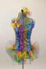Rainbow colored square-sequined camisole leotard has attached rainbow colored, curly organza ruffle skirt. Comes with matching rainbow hair accessory.  Front