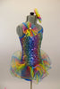 Rainbow colored square-sequined camisole leotard has attached rainbow colored, curly organza ruffle skirt. Comes with matching rainbow hair accessory. Right side