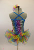 Rainbow colored square-sequined camisole leotard has attached rainbow colored, curly organza ruffle skirt. Comes with matching rainbow hair accessory. Back