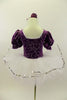 Purple velvet leotard has pouf sleeves & silver pattern. Neck-line is square cut with silver edging & large silver front bow. Comes with white pull-on tutu & floral hair accessory. Back