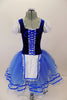 Peasant style  ballet dress has blue velvet bodice ,corset tie front & pouf sleeves. Skirt is layers of blue tulle with ribbon accent and a white apron. Comes with hair accessory. Front