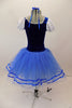 Peasant style  ballet dress has blue velvet bodice ,corset tie front & pouf sleeves. Skirt is layers of blue tulle with ribbon accent and a white apron. Comes with hair accessory. Back