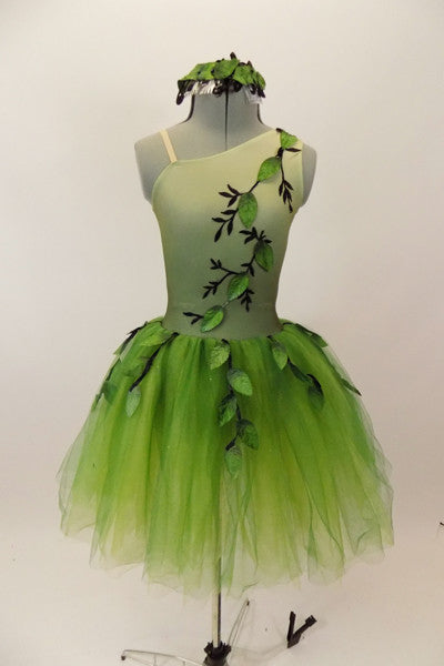 Forest themed green romantic tutu dress has single shoulder with ribbon branches & 3-D leaves.Tutu is layers of soft green fading tulle. Has leaf hair accessory. Front