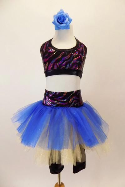 Black capri legging is attached to a gold & blue tutu with colorful sparkle waistband. The halter half top matches the waistband. Has blue floral hair accessory. Front