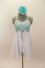 Aqua sequined leotard dress has cross back straps. Attached open-front white chiffon skirt has crystal rose brooch accent. Comes with aqua floral hair piece. Front
