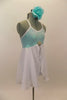 Aqua sequined leotard dress has cross back straps. Attached open-front white chiffon skirt has crystal rose brooch accent. Comes with aqua floral hair piece. Right side