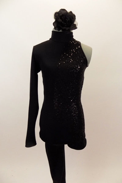 Black high neck unitard has one long leg and one sleeve & open back. There is a swirling pattern of black sequin along  left side. Has black hair accessory. Front
