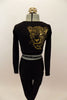 Long sleeved black crop top has large gold leopard/tiger with Swarovski eyes on right back shoulder. Accompanied by matching black leggings. Has gold hair piece. Back