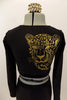 Long sleeved black crop top has large gold leopard/tiger with Swarovski eyes on right back shoulder. Accompanied by matching black leggings. Has gold hair piece. Back zoomed