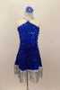 Large sequined blue dress has dangling silver sequin fringe. Bodice comes to a point at neck where it joins to silver straps. Has low back & blue hair accessory. Front