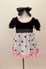 Dress has black velvet bodice with pouf sleeves, pink satin trim & bows. Skirt is white mesh with black dots & pink satin trim. Has dotted waist sash & hair bow, Front