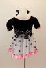 Dress has black velvet bodice with pouf sleeves, pink satin trim & bows. Skirt is white mesh with black dots & pink satin trim. Has dotted waist sash & hair bow. Back