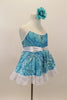 Camisole leotard dress has swirls  of blues on aqua base. Has a white petticoat and wide lace trim. White satin waist sash had a crystal heart. Has floral hair accessory. Side
