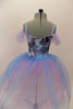 Blue and pink marbled velvet bodice has attached romantic tutu of pink & blue tulle. Bodice has pink and mauve roses & off-shoulder lavender tulle pouf sleeves. Comes with rose hair accessory. Back