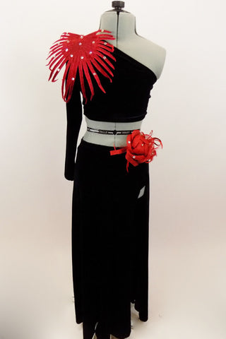 Black velvet 2-piece costume has one long sleeve & shoulder half top with large red floral leaf accessory at  shoulder. The long skirt has full length slit. Comes with red floral hair accessory. Front