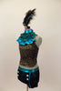 Black & gold lace halter has separate ruffled high neck turquoise collar. Lace shorts have turquoise piping & button accents. Has large feather hair accessory. Left side