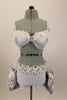 Costume has white bra (36A) with chiffon ruffle,beaded lace & grey draping. Bottom is white short & silver silk pouf bustle, white organza roses, feathers & curly ruffle. Has matching hair accessory. Front