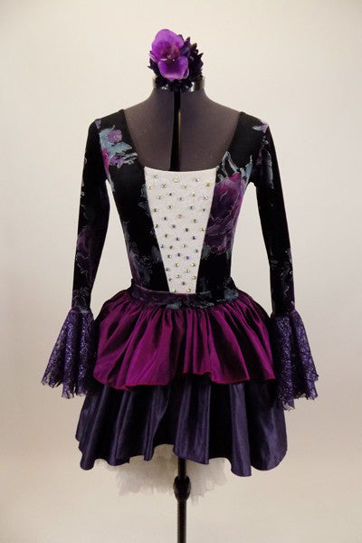 Jewel-tone velvet floral long sleeved leotard has white lace crystaled front torso & trumpet lace sleeves. Has pull-on skirt with ruffled jewel toned layers & matching floral hair accessory. Front